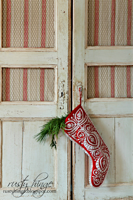 Antique French linen armoire with red Christmas stocking