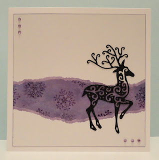 Christmas card with purple snowflake panel and black glitter reindeer
