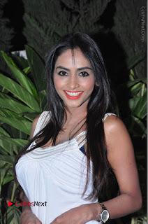Actress Model Pooja Sri Stills in White Short Dress at F Club pre soft Launch  0031.JPG