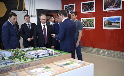 During his visit to the Datsyuk Arena sports complex, Vladimir Putin inspects a scale model of the sports and educational cluster to be constructed in Yekaterinburg's new neighborhood.