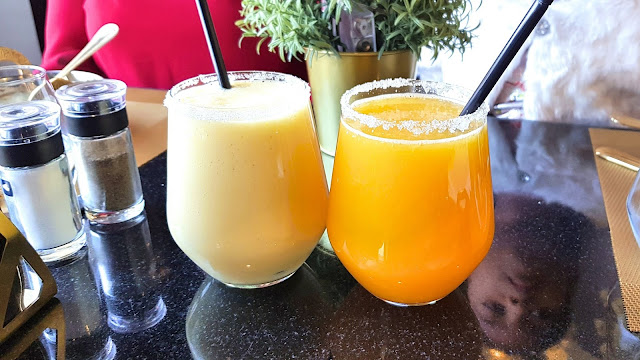 Orange juice and mango lassi at Magan, Kuwait