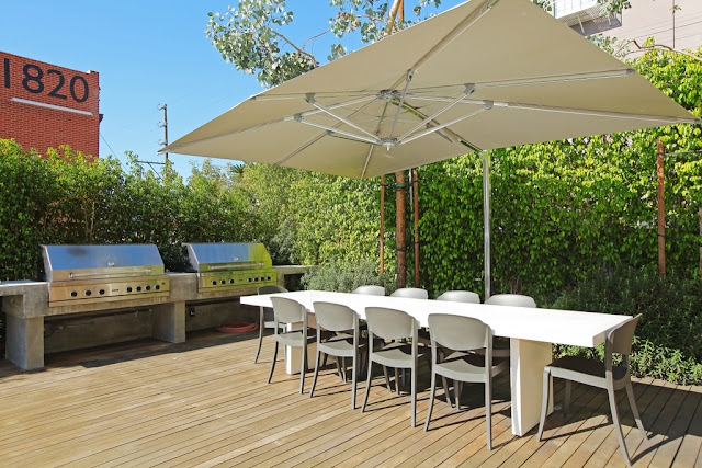 Photo of outdoor barbecue and the table on one of the terraces
