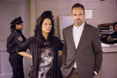 Jonny Lee Miller and Lucy Liu as Sherlock Holmes and Joan Watson in CBS Elementary Season 2 Episode 6 An Unnatural Arrangement