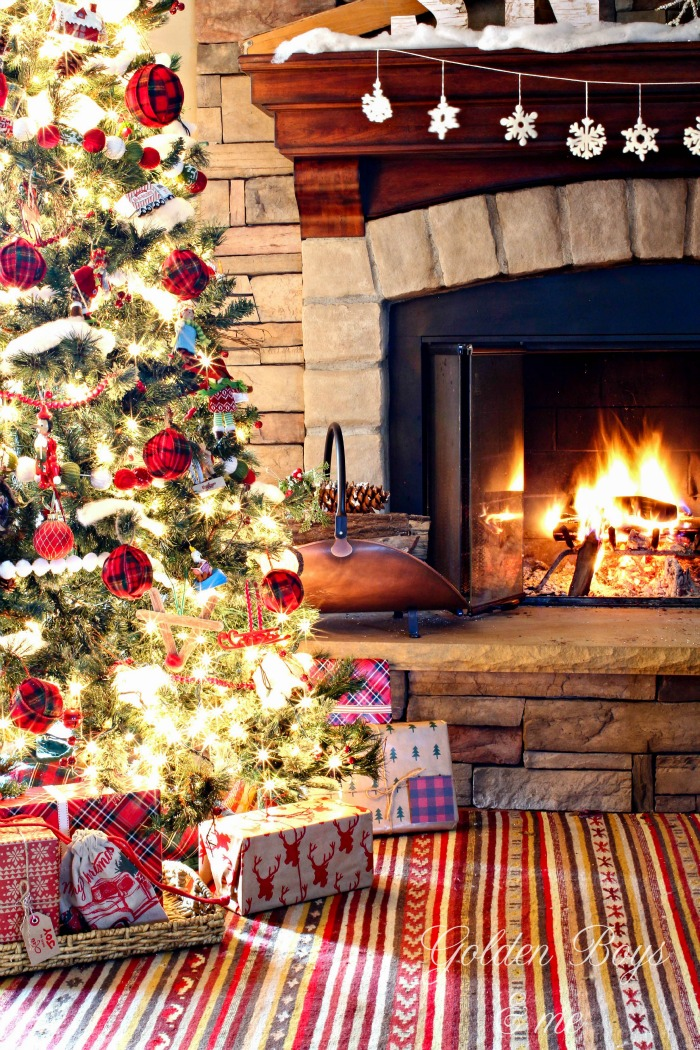 Rustic ski lodge style Christmas decor with stone fireplace and plaid - www.goldenboysandme.com