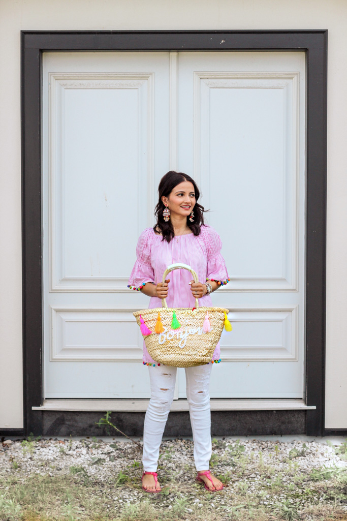 Pink Pom Pom trim shirt with Bonjour Straw Tassel Bag