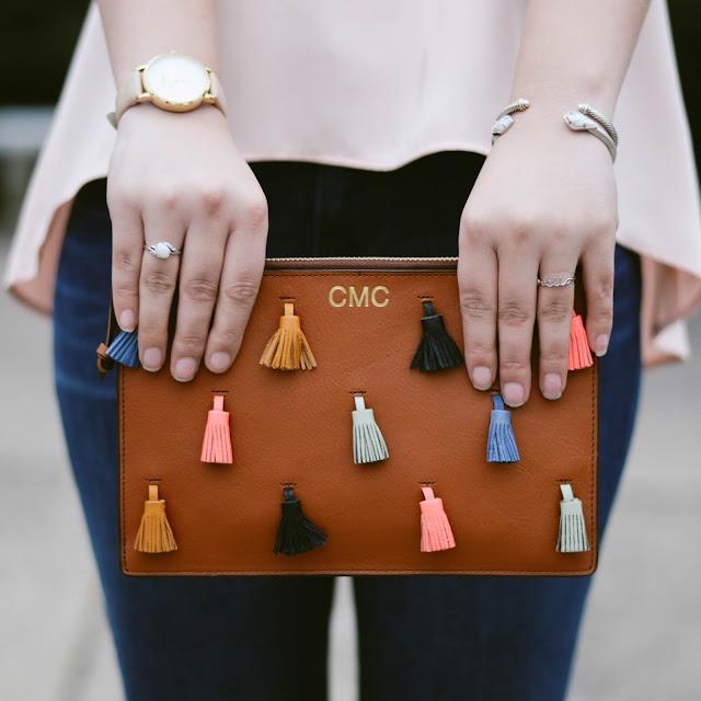 monogrammed tassel clutch