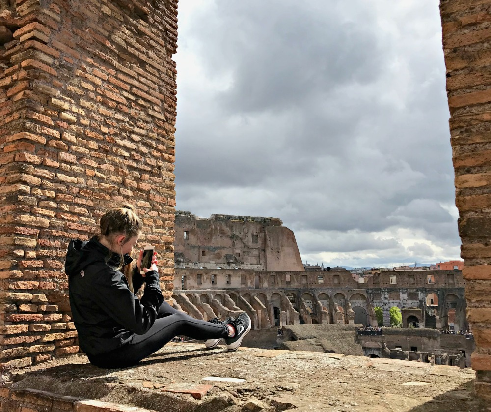 Colosseum picture with teen girl