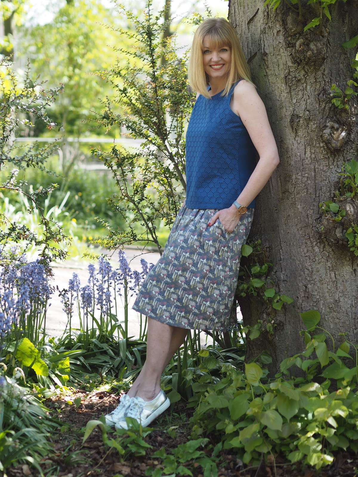 What-Lizzy-Loves- blue-broderie-shell-top-floral-skirt-silver-Superga-sneakers-pumps