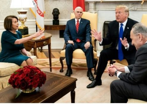 President Trump threatens to shut down US government if opposition congressional leaders fail to fund the border wall
