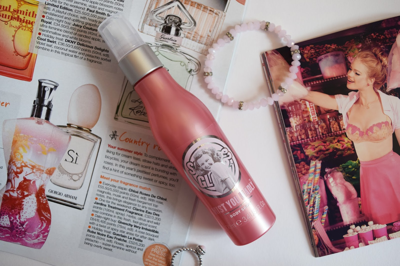 a pink bottle of mist you madly body spray