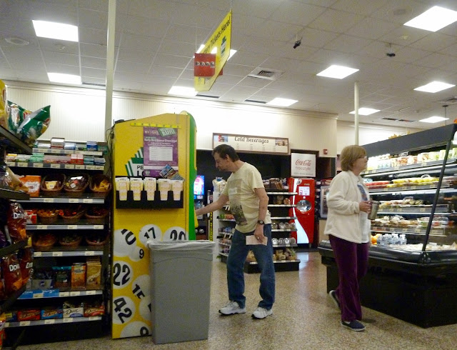 man buying lottery tickets from machine