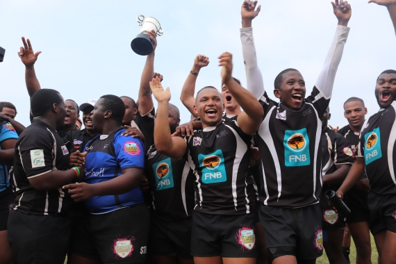 Rugby players from UKZN Durban celebrate their Junior Murray Cup win.
