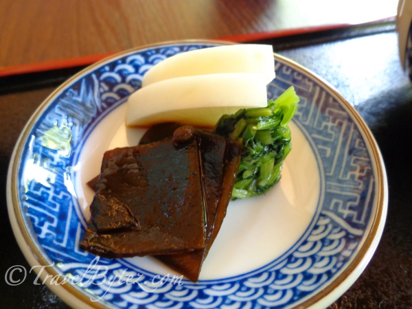 Some gelatin cold dish with radish and vegetables on the side. It went along well with the rice and the...