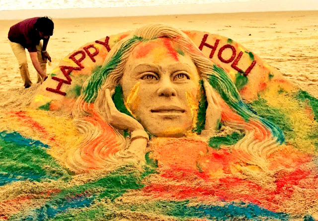 Sandy Happy Holi Wish By Sudarsan Pattnaik at Puri Sea Beach, sand art, Sudarshan wrote: #‎HappyHoli‬ May your life be colored with joy! . My ‪#‎sandart‬ at ‪#‎puribeach‬ in Odisha