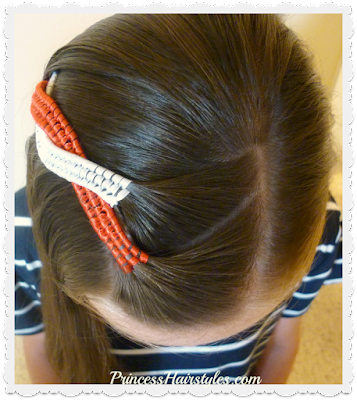 Cute ribbon hairstyle for the 4th of July.
