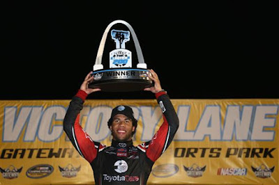 Darrell Wallace Jr., driver of the Toyota Toyota, celebrates in victory lane after winning the NASCAR Camping World Truck Series Drivin' For Linemen 200 at Gateway Motorsports Park on June 14, 2014 in Madison, Illinois.