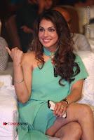 Actress Isha Koppikar Pos in Green Dress at Keshava Telugu Movie Audio Launch .COM 0041.jpg