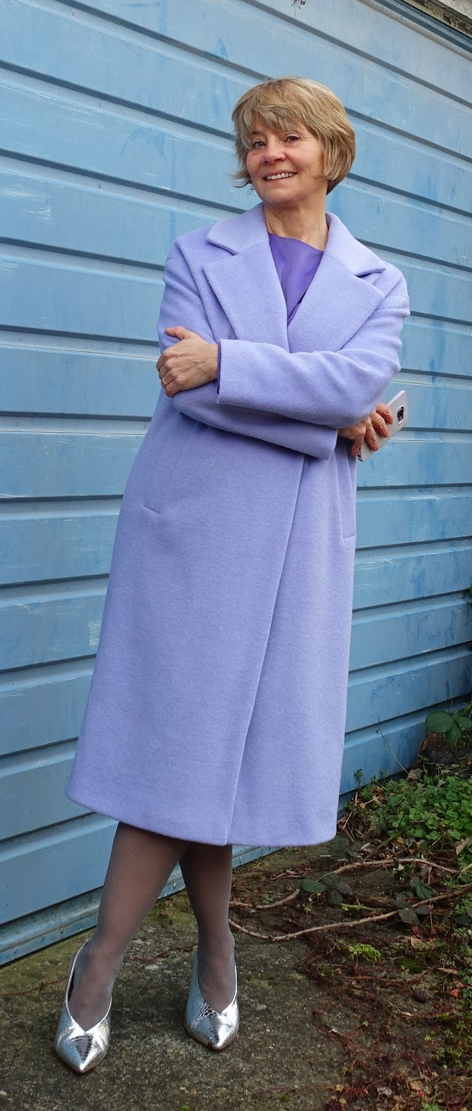 Image showing an over 40s woman in ice cream colours for spring 2018: lilac and purple.