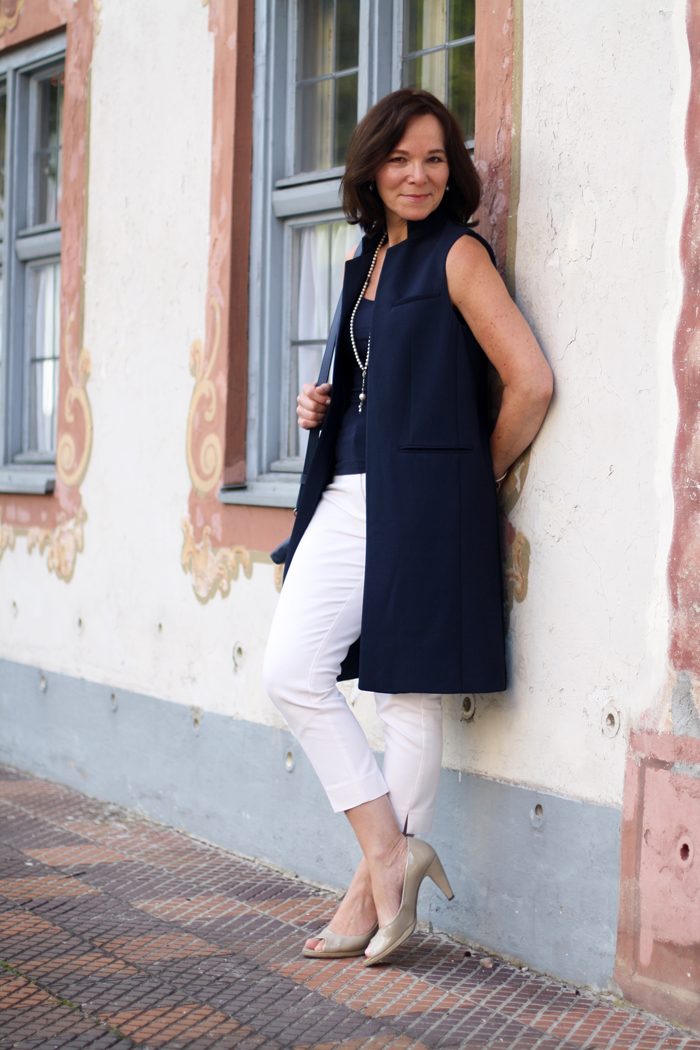 Long Blue Vest by Zara and white cropped trousers classic style