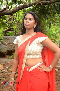 Actress Rishika Pictures in Red Saree at Lovers Park Movie Opening  0088