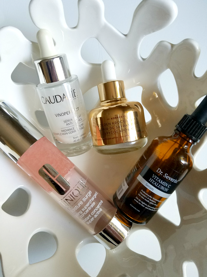 Dr. Severin Vitamin C Hyaluron Serum - CAUDALIE Vinoperfect Radiance Serum Complexion Correcting - KORRES Golden Krocus Elixir - CLINIQUE Moisture Surge Hydrating Supercharged Concentrate