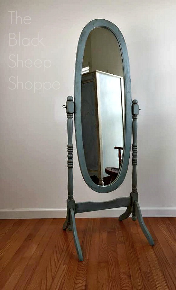 Cheval mirror given an antiqued finish