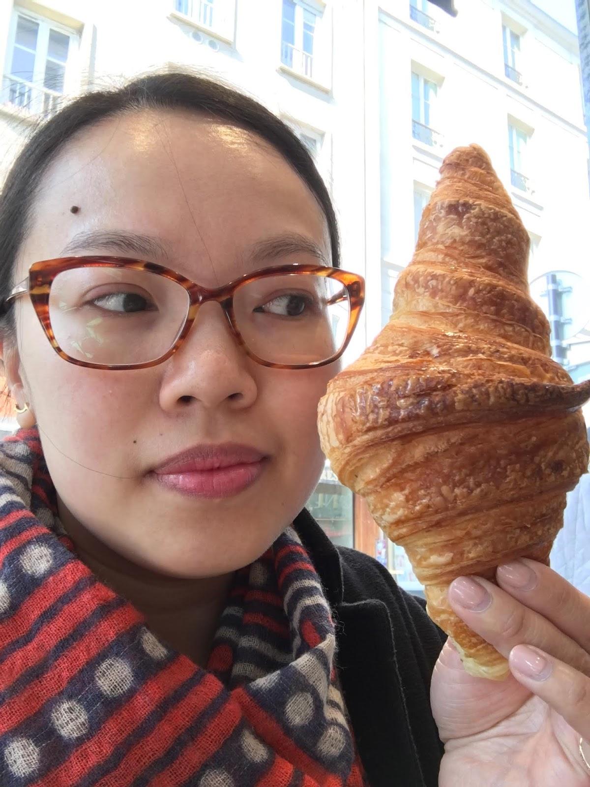 Holding up a giant Parisian croissant