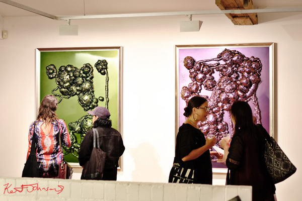 Symmetry, two paintings, four patrons. Dale Frank SABCO PEROXIDE exhibition at Roslyn Oxley9. Photos by Kent Johnson.
