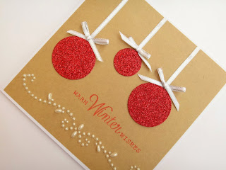 Hand made Christmas card with glitter baubles and a pearl flourish