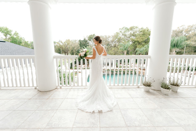 Featuring low back wedding dress