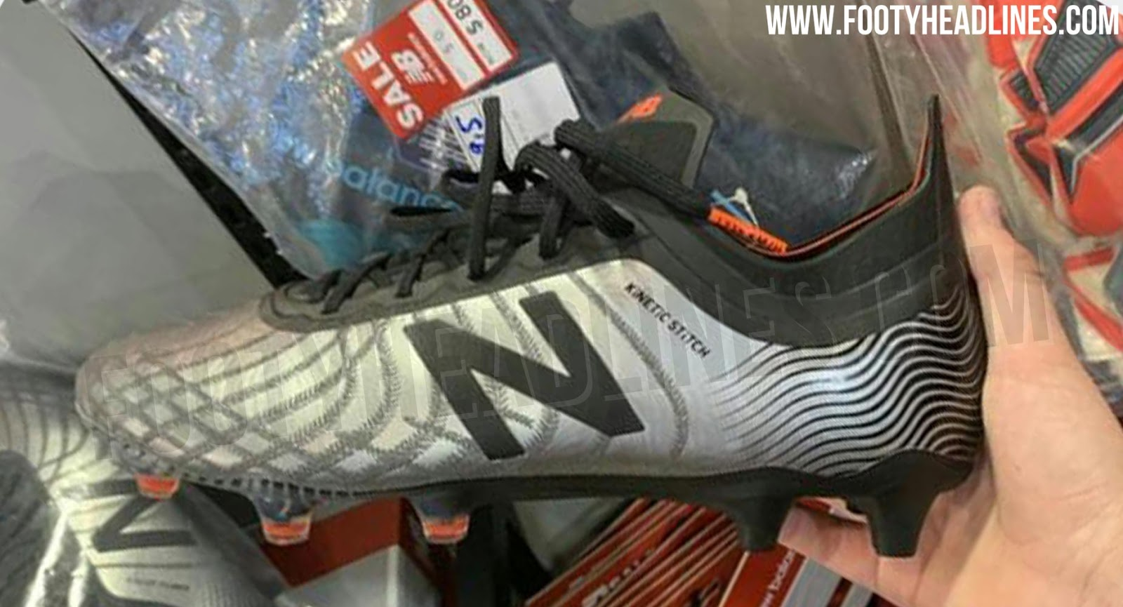 e6142fc23 The lower-tier version of the blackout New Balance Tekela 2.0 football boot  comes with a more shiny