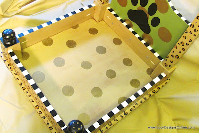 paw print on dog bed hand painted with stripes