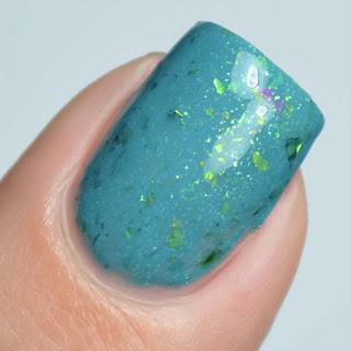 teal nail polish with green flakies