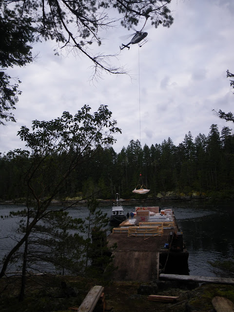 The helicopter lift from barge to lot.