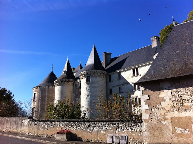 The towers of Chateau de La Guerche against a blue sky