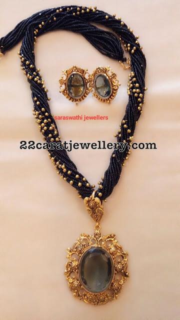 Black Beads Set with Tanzanite