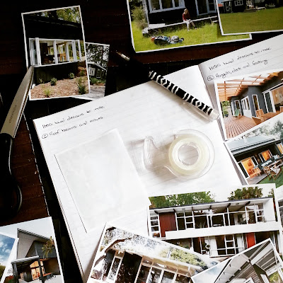 Notebook with scissors, pen and double sided tape next to a collection of cut-out pictures of holiday homes.