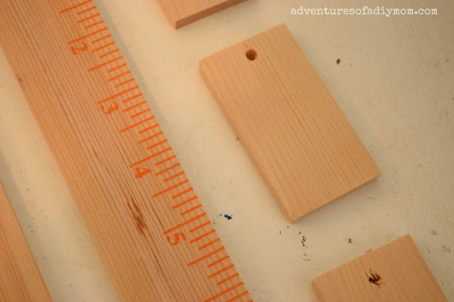 Paint sticks to wooden tags
