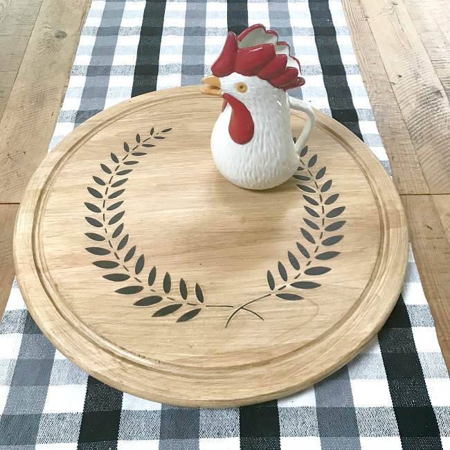 Large farmhouse table with lazy susan and rooster