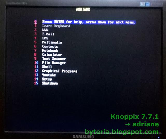 Menu do Knoppix Adriane para deficientes visuais: (0) Ajuda; (1) Aprender Teclado; (2) Internet; (3) Email; (4) SMS; (5) Multimidia; (6) Contactos; (7) Notebook; (8) Calculadora; (9) Reconhecimento de texto; (10) Gerenciador de arquivos; (11) Shell; (12) Programas gráficos; (13) Youtube; (14) Configurações; (15) Desligar.