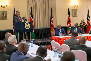 President Kenyatta signs the interest rate bill.