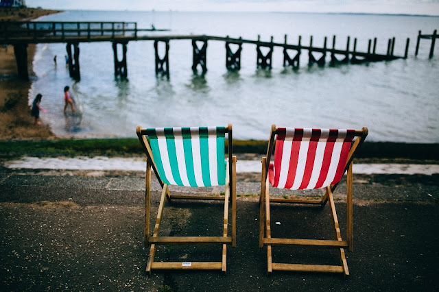 Stripy deckchairs on a beachfront