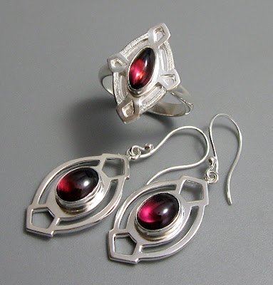 Handmade Argentium sterling silver and rhodolite garnet earrings and rings.