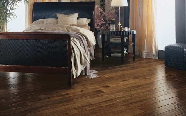 Hardwood flooring is a beautiful choice for a bedroom.