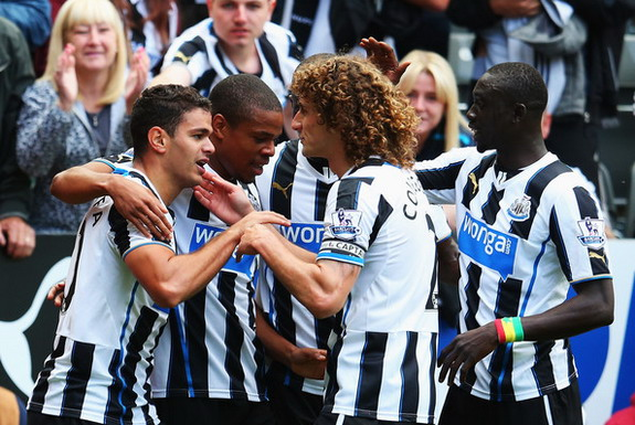 Hatem Ben Arfa celebrates with Newcastle teammates after scoring the winning goal against Fulham