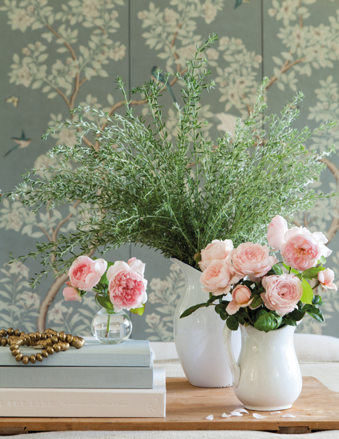 Patina Farm pink roses in white ironstone vases with Gracie wallcovering in background
