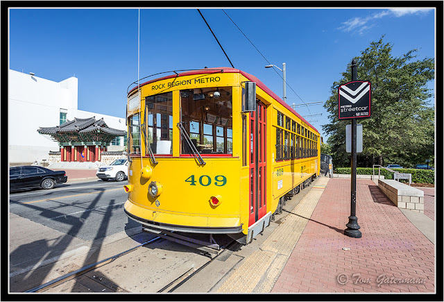 Metro Streetcar 409 is at the Main Street Bridge stop, across the the Songahm Martial Arts Gate.