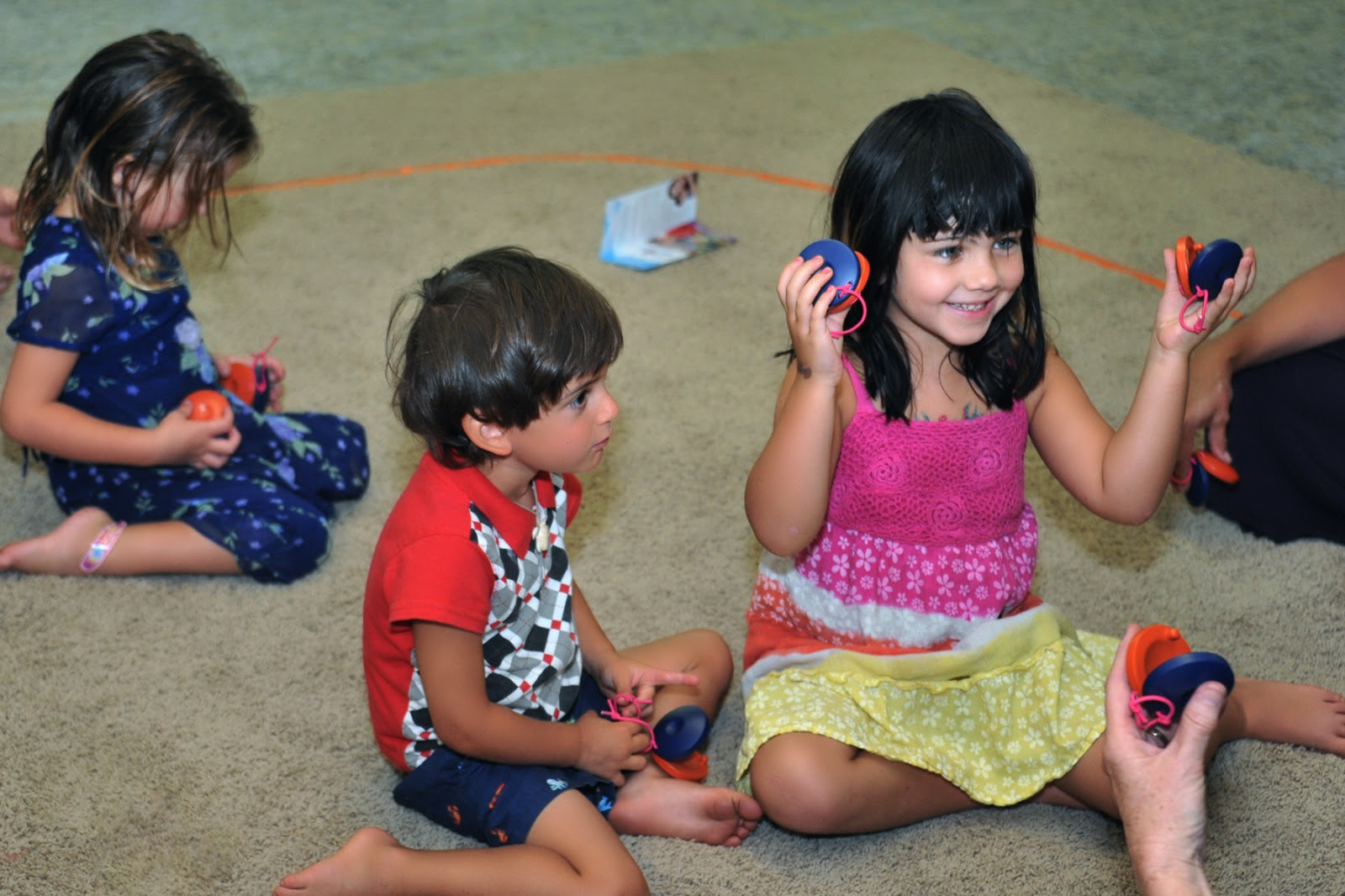musically montessori learning to use scissors by playing
