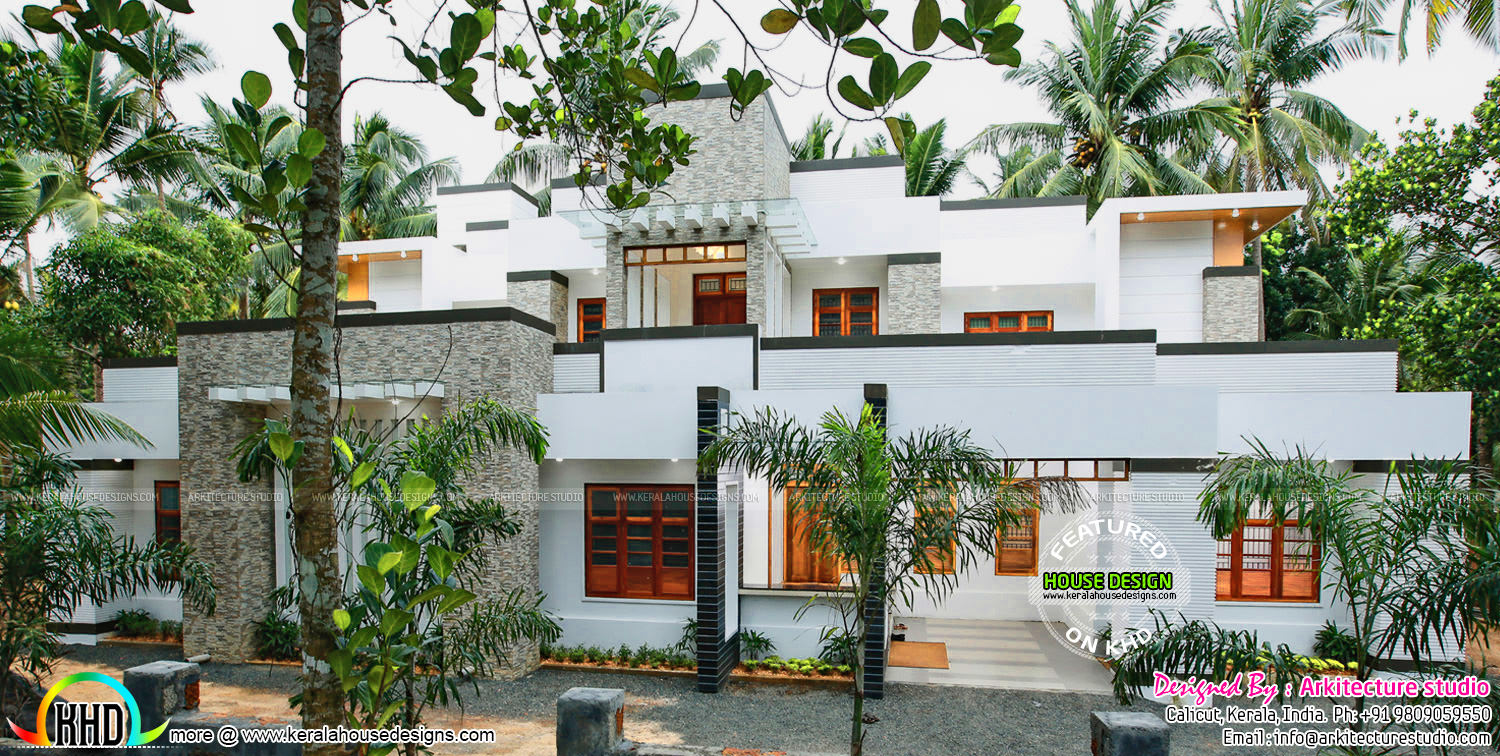 Beautiful contemporary finished kerala home kerala home for House plans with finished photos