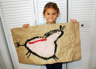 Tessa's completed cave painting! I love how it turned out. I thought about having her add a handprint on the side, but I chickened out.